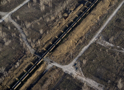 Terry Evans, 'Train loaded with petcoke moving through brown field, site of former steel mill, in Southeast Chicago', 2015