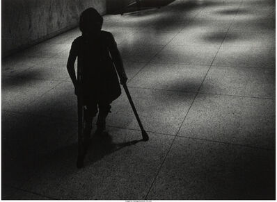 W. Eugene Smith, 'Silhouetted girl on crutches walking down hospital hall', circa 1966-68