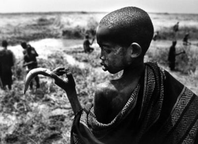 Sebastião Salgado, 'Fishing in the marshes of the Gel Canal, which is filled with waters from the Nile River, Southern Sudan ', 2006