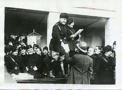 Unknown, 'Mussolini Awarding Veterans in Littoria', 1933