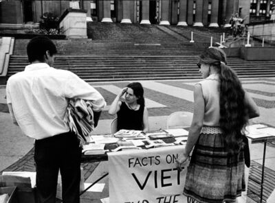 Garry Winogrand, 'Columbia University Student Amelia Rechel Handing Out Anti-Vietnam War Literature at Information Table on Campus, NYC', 1966