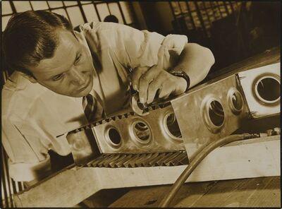 Margaret Bourke-White, 'Man doing metalwork'