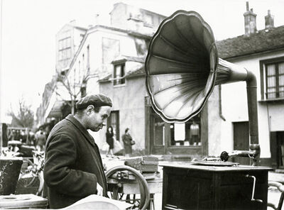 Robert Doisneau, 'Man and Phonograph at the Flea Market (Marché aux puces du Kremlin Bicêtre)', 1947c/1960s