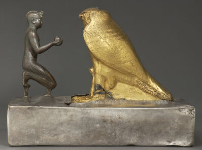 'Taharqa présente des vases à vin au dieu Hémen (Statuette of Taharqa and the Falcon God)', bronze (king), gold plated greywacke (Hemen) plated wooden base, silver