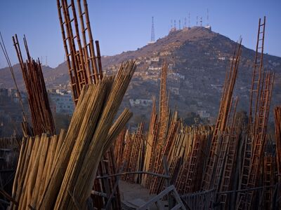 Simon Norfolk, 'Shop For Construction Materials. American Surveillance Antennae On The Hills, Kabul', 2010
