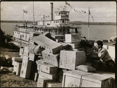 Margaret Bourke-White, 'The S.S. Distributor steamship unloading supplies at a stop on the Mackenzie River during Governor Gen. John Buchan's visit to the NW Territory, July 1937', 1937