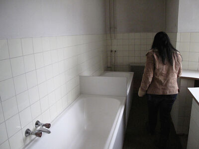 Hans Weiss, 'CHRISTINE J., on first visiting the bathroom in the cloister where she had been repeatedly tortured and raped by Catholic nuns. Martinsbühel near Innsbruck, Austria (April 14, 2012)'