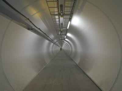"Gianni Motti, '""HIGGS, looking for the anti-Motti"", CERN, Genève', 2005"