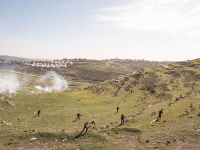 Peter van Agtmael, 'Palestinian protestors run from tear gas fired by Israeli soldiers at a weekly protest against the Israeli occupation. Nabi Saleh, West Bank. ', 2013
