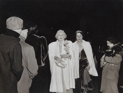 Weegee, 'The Critic, November 22, 1943 [Mrs Cavanaugh and Friend About to enter the Metropolitan Opera House]', 1960's