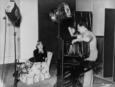 """Virgil Apger, 'Clarence Sinclair Bull photographing Myrna Loy in """"The Thin Man""""', 1934"""