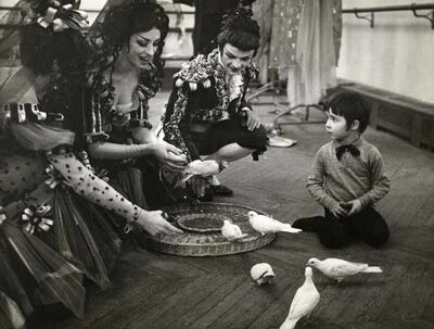 Robert Doisneau, 'Boy with Doves and Circus Perfomers', 1960s/1970c