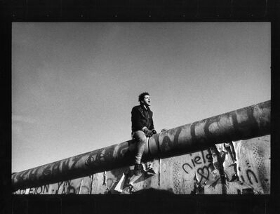Raymond Depardon, 'Between the Brandenburg Gate and Potsdamer Platz. November 11th, 1989. A young man sits on the wall between East and West Berlin.', 1989