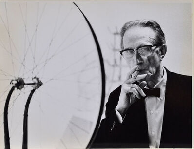 Julian Wasser, 'Duchamp smoking Cigar next to Bicycle Wheel, Duchamp Retrospective, Pasadena Art Museum', 1963