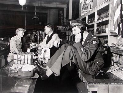 Peter Stackpole, 'Jimmy Stewart Talking Behind Counter at His Father's Hardware Store While His Father Chats with Customer upon Stewar's Return from WWII, Indiana, PA', 1947