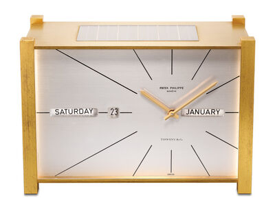 """Patek Philippe, 'An attractive and unusual gilt brass solar powered perpetual calendar presentation table clock with """"straight line"""" display, retailed by Tiffany & Co.', 1967"""