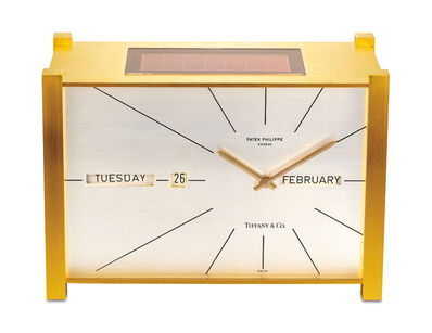 "Patek Philippe, 'An attractive and well preserved gilt brass solar powered perpetual calendar table clock with ""straight line"" display, retailed by Tiffany & Co.', 1968"
