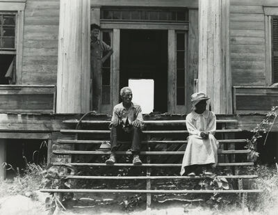 Dorothea Lange, 'Ex-slave and wife on steps of plantation house now in decay, Greene County, Georgia', 1937