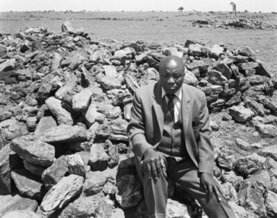 "David Goldblatt, 'Luke Kgatitsoe at his house, bulldozed in February 1984 by the government after the forced removal of the people of Mapoga, a black-owned farm, which had been declared a ""black spot"", Ventersdorp district, Transvaal. 21 October 1986 ', 1986"