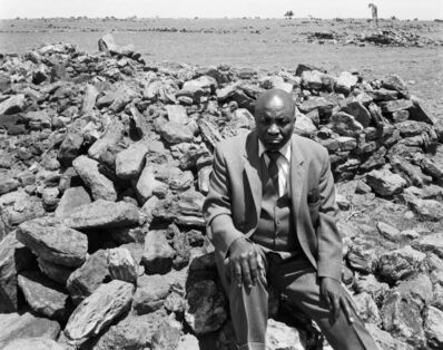 "David Goldblatt, 'Luke Kgatitsoe at his house, bulldozed in February 1984 by the government after the forced removal of the people of Mapoga, a black-owned farm, which had been declared a ""black spot"", Ventersdorp district, Transvaal.', October 21-1986"