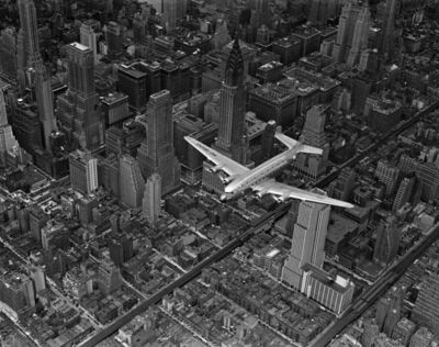 Margaret Bourke-White, 'A DC-4 Flying over New York City', 1939