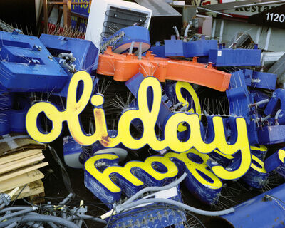 Lisa Kereszi, ''Oliday sign in scrap pile, Oregon', 2009