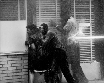 Charles Moore, 'Three People in Doorway Being Fire Hosed, Birmingham, AL', 1963