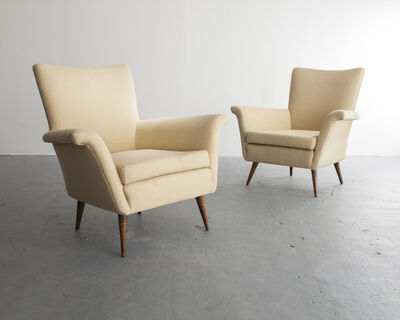 "Joaquim Tenreiro, 'Pair of upholstered lounge chairs with turned hardwood legs. Designed by Joaquim Tenreiro, Brazil, 1950s. (Seat: 16"")', ca. 1950"