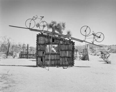 LaToya Ruby Frazier, 'Pat Brunty, the caretaker standing behind No Contest 1994, Noah Purifoy Outdoor Desert Art Museum, Joshua Tree, CA', 2016 / 2017