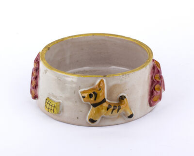 I.C.S., 'Bowl with puppies and relief decorations'