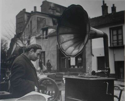 Robert Doisneau, 'Man at flea market with vinyl player, France', ca. 1950
