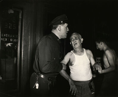 Weegee, 'Landlord Henry Geller weeping over the loss of his first-floor tobacco shop, which was destroyed by fire , New York', July 27-1941