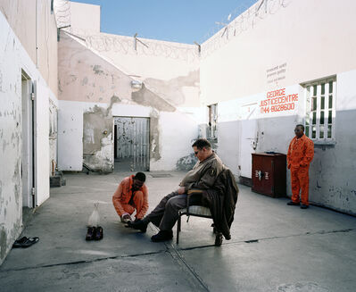 "Mikhael Subotzky, 'Shining the Warder's Shoes, Beaufort West Prison (from the series ""Beaufort West""))', 2006"