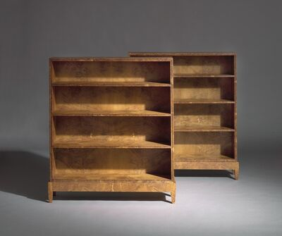 Kaare Klint, 'A pair of early and unique bookcases of oak burl. Front edges with profiles. Mounted on legframes.'
