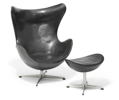 "Arne Jacobsen, '""The Egg Chair"". Early easy chair with matching footstool with profiled aluminum base.'"