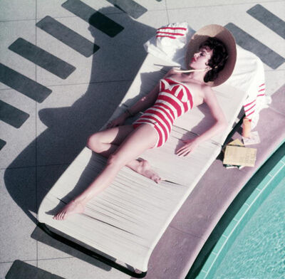 Slim Aarons, 'Mara Lane at The Sands, 1954: Austrian actress Mara Lane lounging by the pool in a red and white striped bathing costume, Las Vegas', 1954
