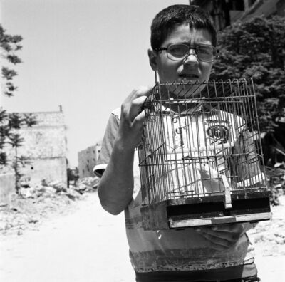 Katharine Cooper, 'Hussein with his Birdcage at Kastal al-Harami, Eastern Aleppo, May 2017 - Aleppo', 2017