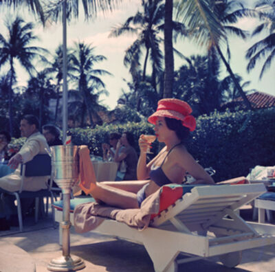 Slim Aarons, 'Leisure and Fashion, 1961: A woman watching a poolside fashion show at the Colony Hotel, Palm Beach', 1961
