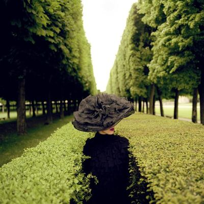 "Rodney Smith, '""Woman with Hat Between Hedges, Parc de Sceaux, France""', ca. 2003"