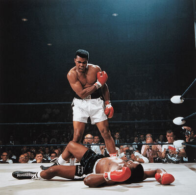 Neil Leifer, 'Muhammad Ali reacts after his first round knockout of Sonny Liston during the 1965 World Heavyweight Title fight at St. Dominic's Arena, Lewiston, Maine', 1965