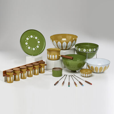 """Catherineholm, 'Twenty pieces: """"Lotus"""" pattern enamelware, plus extras including partial fondue set with lidded fondue pot on stand, tray, sterno container and snuffer, six fondue forks, three bowls, butter pan, and six lidded spice canisters with wall-mounted rack', 1960s"""