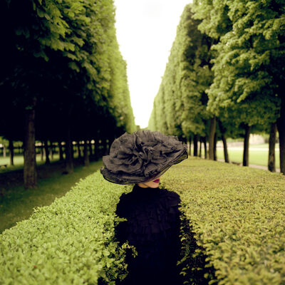 Rodney Smith, 'Woman with hat between hedges', 2004