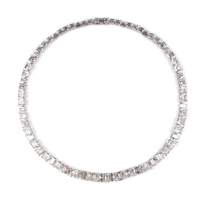 Cartier, 'Square and rectangular cut diamond necklace by Cartier, London, graduated to the front, every three square cut stones spaced by a baguette cut, the square cut diamonds claw set, the baguette diamonds collet set, signed 'Cartier London, together with a Cartier case', ca. 1950