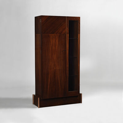 André Sornay, 'Cabinet with full door on left and a glass door on right. Four bronze cylinders in corners.', ca. 1929