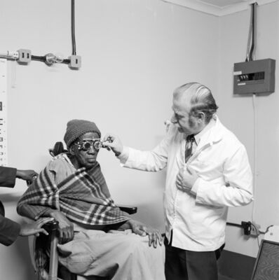 David Goldblatt, 'Eyesight testing at the Vosloosrus Eye Clinic of the Boksburg Lions Club', 1980