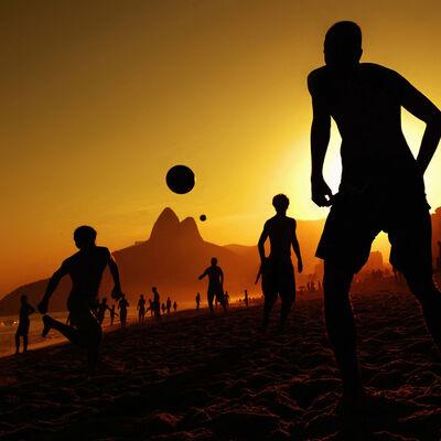 "Ana Carolina Fernandes, ' Boys play ""Altinho"" on Ipanema beach in the late afternoon', 2013"