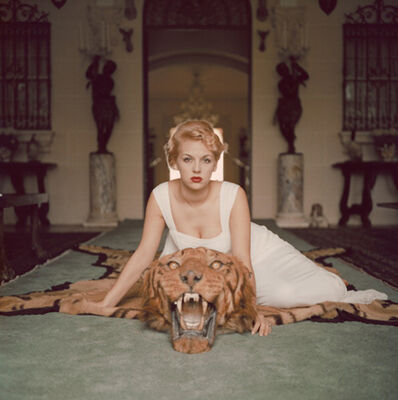 Slim Aarons, 'Beauty And The Beast, 1959: Lady Daphne Cameron (Mrs George Cameron) on a tiger skin rug in the trophy room at socialite Laddie Sanford's home, Palm Beach', 1959