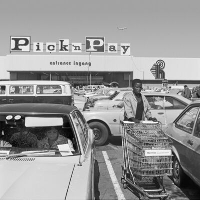 David Goldblatt, 'Hypermarket employee collecting trolleys, Boksburg', 1980