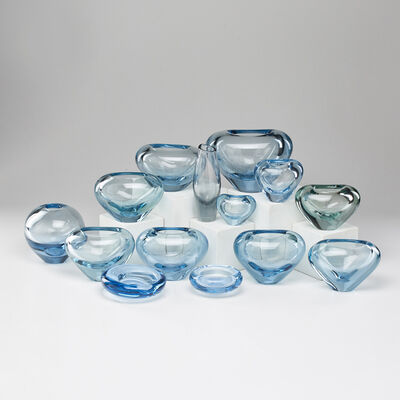 Holmegaard, 'Group of fourteen blue-tinted glass pieces: twelve vases (one Orrefors), and two shallow bowls', 1950s