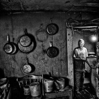 Matt Black, 'A woman in her kitchen. Rome, Mississippi. USA. ', 2017
